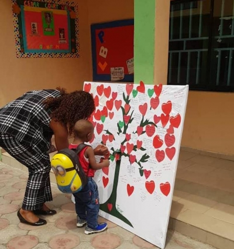 Valantine's Day 2020. Parents Reading Love Notes From Their Kids on the CCIBS Love Tree Presented By Their Kids